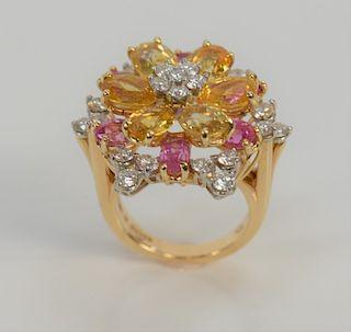 18 karat gold ring, set with diamonds and sapphires having twenty-four round brilliant cut diamonds, six oval yellow sapphires, and ...