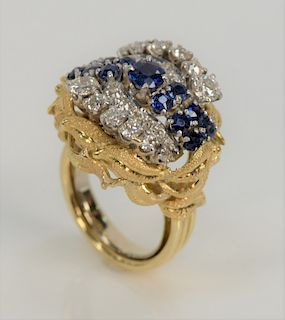 18 karat gold sapphire and diamond ring, set with thirteen blue sapphires, approximately 2 cts., and twenty-two round cut diamonds ...