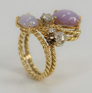 18 karat gold diamond and lavender star sapphire ring, set with two oval lavender star sapphires, 7.75 cts. total and five round dia...