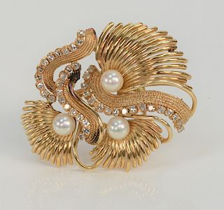 18 karat gold pendant/brooch, set with three pearls and three curved lines of diamonds.  length 2 1/8 inches, 20 grams total weight