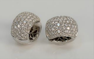 Pair of 18 karat white gold and diamond earrings, round form, set with seventy-three diamonds in each, marked: 750, 18 karat. 19.6 g...
