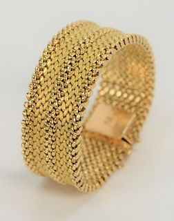 18 karat gold bracelet, mesh style with three polished and two brushed finish bands.  length 7 inch, width 15/16 inches, 46.2 grams