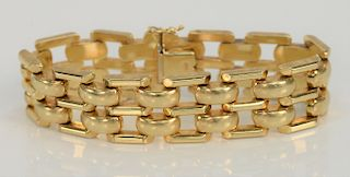 14 karat gold bracelet with domed connectors.  length 7 1/2 inches, width 3/4 inch, 39.8 grams