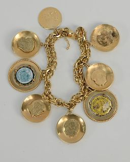 14 karat gold charm bracelet with 14 karat gold charms. length 7 1/4 inches, 59.5 grams