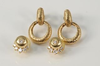 Two pairs of 14 karat gold ear clips to include a double circles of brushed gold and a pair of two part earrings, set with five diam...