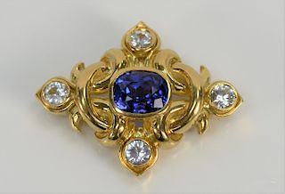 18 karat gold brooch/pendant, set with center tanzanite and with four white topaz. height 1 1/4 inch, width 1 5/8 inch, 23.3 grams tota...