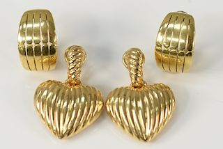 Two pairs of earrings to include a pair of 18 karat gold pierced earrings and a pair of 18 karat gold heart shaped earrings with fil...