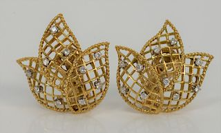 Pair of 14 karat gold ear clips of three part flower, set with ten small diamonds in each.  11.6 grams