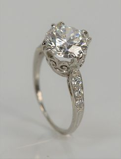 2.70 ct. round brilliant cut diamond engagement ring with G.I.A. report, center diamond flanked by six small diamonds. E color, VVS2...