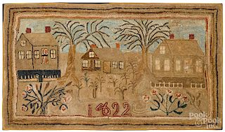 Large American hooked rug with houses