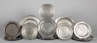 Eleven English pewter plates