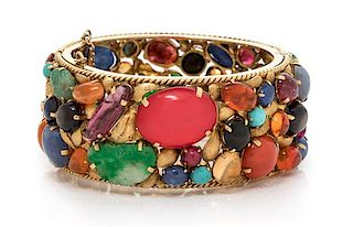 An 18 Karat Yellow Gold and Multigem Bangle Bracelet, 54.25 dwts.