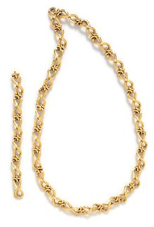 An 18 Karat Yellow Gold Convertible Longchain Necklace/Bracelet, Carlo Weingrill, 103.90 dwts.