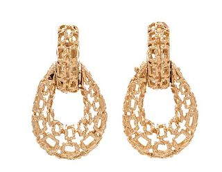 A Pair of 14 Karat Yellow Gold Earclips, 17.60 dwts.