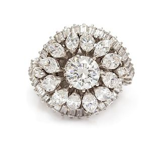 A Platinum and Diamond Bombe Ring, 11.80 dwts.
