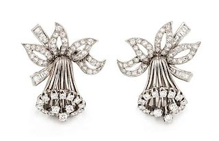 A Pair of Platinum and Diamond Daffodil Motif Earclips, 9.85 dwts.