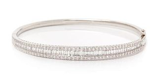 A White Gold and Diamond Bangle Bracelet, 9.60 dwts.