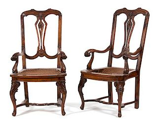 A Pair of Italian Carved Walnut Open Armchairs Height 44 x width 23 x depth 21 inches.