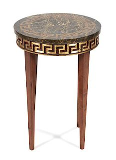 An Italian Directoire Style Occasional Table Height 22 1/2 x diameter 16 inches.
