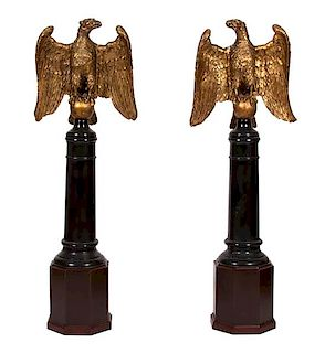 A Pair of Continental Giltwood Eagles on Later Stands Height overall 65 3/4 inches x width 19 x depth 7 inches.