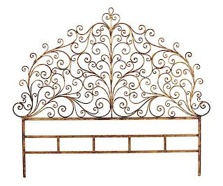 A Rococo Style Gilt Metal Scrollwork Headboard Height 67 x width 78 inches.