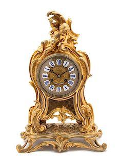 A Louis XV Style Gilt Bronze Shelf Clock Height 18 x width 12 x depth 7 inches.