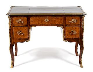 A Louis XV Style Gilt Metal Mounted Parquetry Leather Top Desk Height 30 x width 41 1/2 x depth 23 inches.
