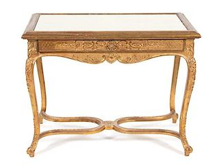 A Louis XV Style Carved Giltwood Center Table Height 30 x width 39 1/2 x depth 25 inches.