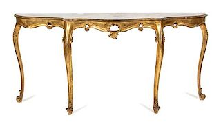 A Louis XV Style Carved Giltwood Serpentine Console Table Height 32 x width 65 inches.