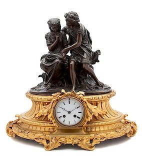 A French Gilt and Patinated Bronze Mantel Clock Height 19 1/2 x width 20 x depth 10 inches.