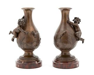 A Pair of Continental Bronze Urns Height 9 x diameter 4 1/2 inches.