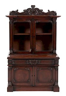 A Victorian Diminutive Carved Mahogany Step-Back Cabinet