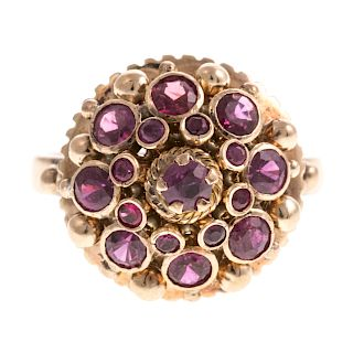 A Ladies Ruby Cluster Ring in 18K