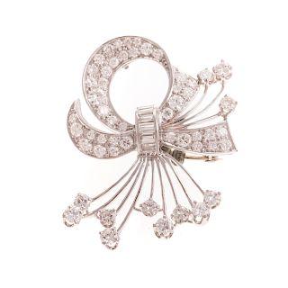 A Ladies Retro Diamond Bow Ribbon Pin in Platinum