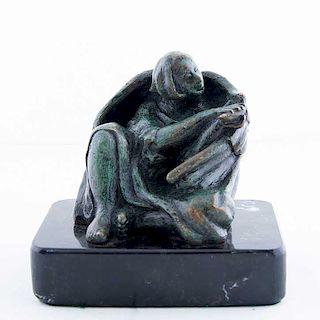 Firmado L. E. García. Ángel con flauta. Fundición en bronce patinado con base mármol negro.