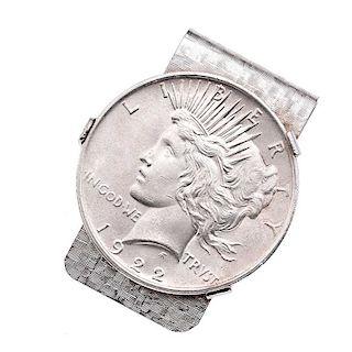 Clip para billetes en metal base. Moneda plata liberty. Peso: 46.5g.