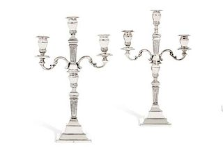 A pair of silver convertible candelabra