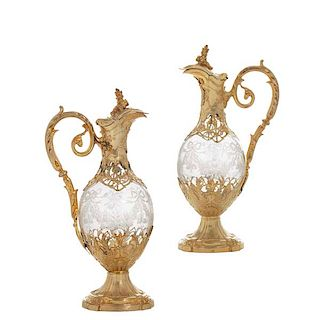 A pair of French silver & glass claret jugs