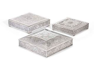 Three Persian silver cigarette boxes