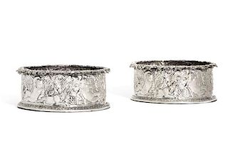 A pair of sterling silver magnum wine coasters