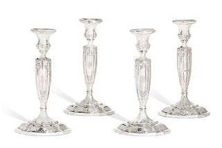 Four Gorham weighted sterling candlesticks