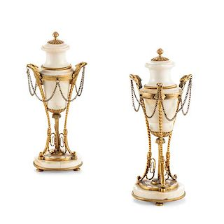 A pair of Louis XVI style marble cassoulettes