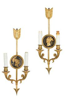 A pair of Empire bronze twin branch wall lights