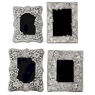 Four silver floral decorated  picture frames