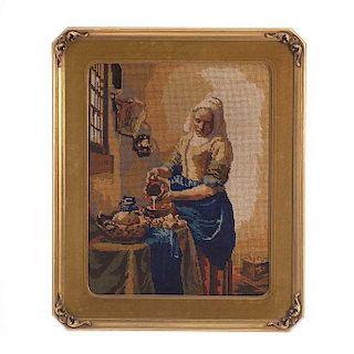 "Gobelino. Siglo XX. ""La Lechera"", copia de Vermeer. Elaborado a máquina sobre fibras de algodón. Enmarcado en madera dorada."