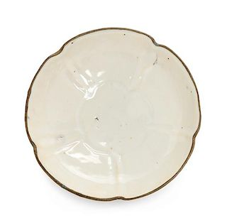 A Ding- Type White Glazed Porcelain Floriform Plate Diameter 5 inches.