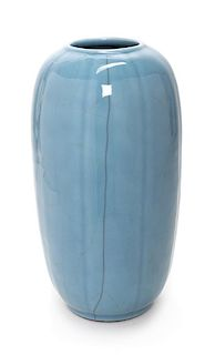 A Guan- Type Porcelain Melon-Form Vase Height 14 1/4 inches.