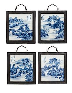 * A Set of Four Blue and White Porcelain Rectangular Plaques Height of each 10 1/2 inches.