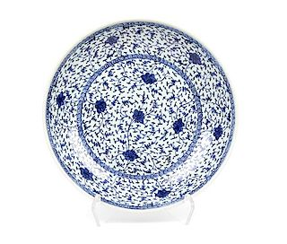 A Blue and White 'Floral' Porcelain Charger Diameter 14 1/2 inches.