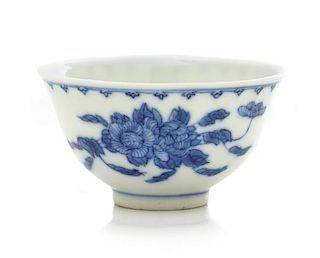 A Blue and White 'Peony' Porcelain Cup Height 1 7/8 inches.